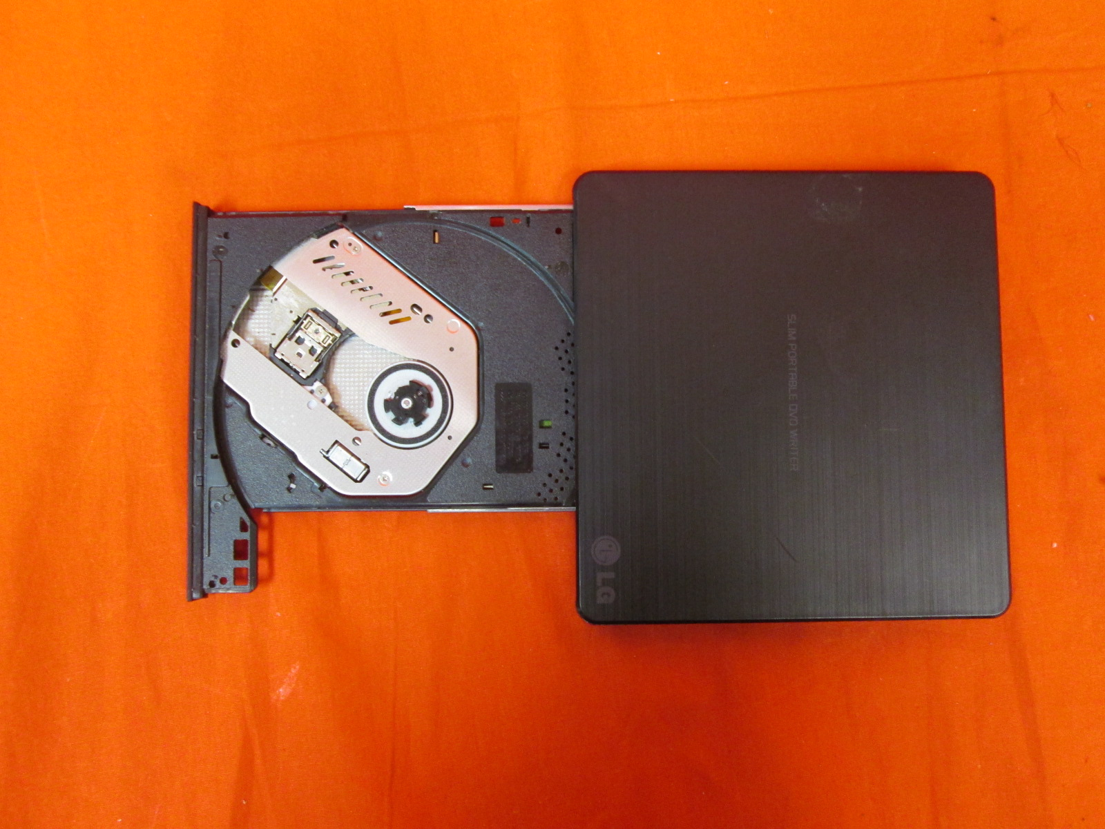 how to open a slim lg portable dvd drive