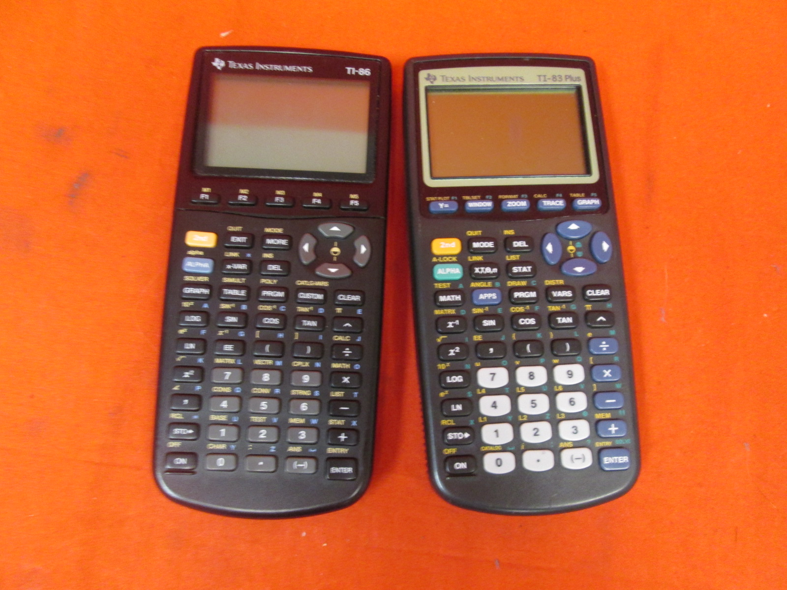 Lot Of 2 Texas Instruments TI-83 Plus TI-86 Graphics Calculators