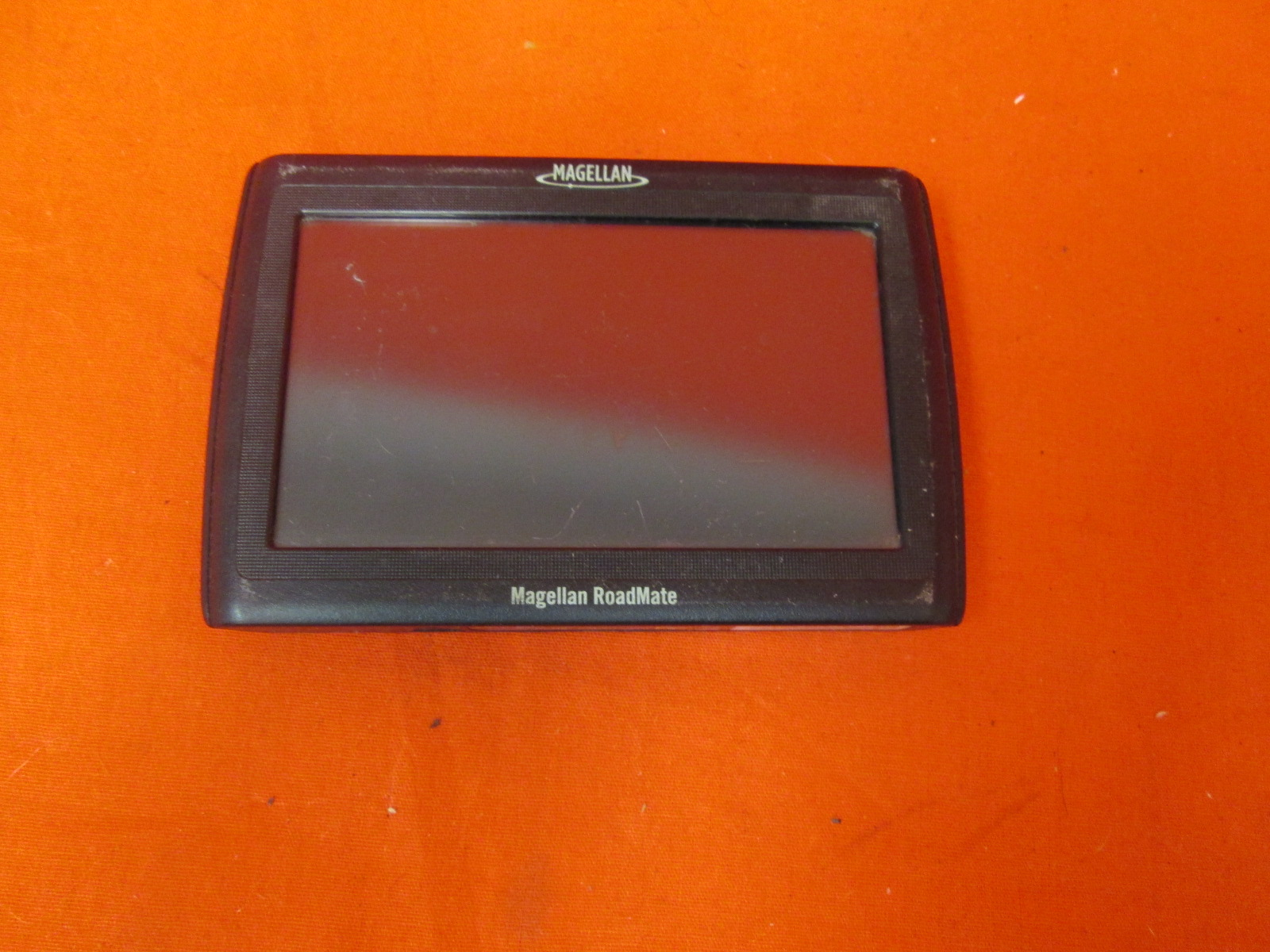 Broken Magellan Roadmate 1424 4.3-inch Widescreen Portable GPS