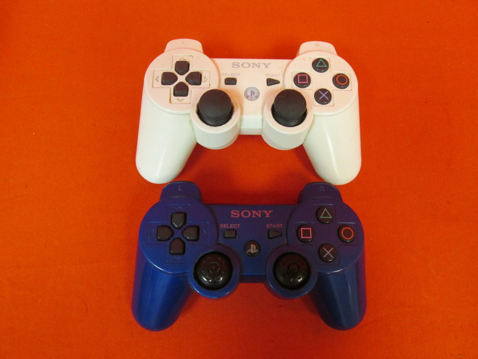 Lot Of 2 Dual Shock 3 Controllers For PlayStation 3 PS3 White And Blue