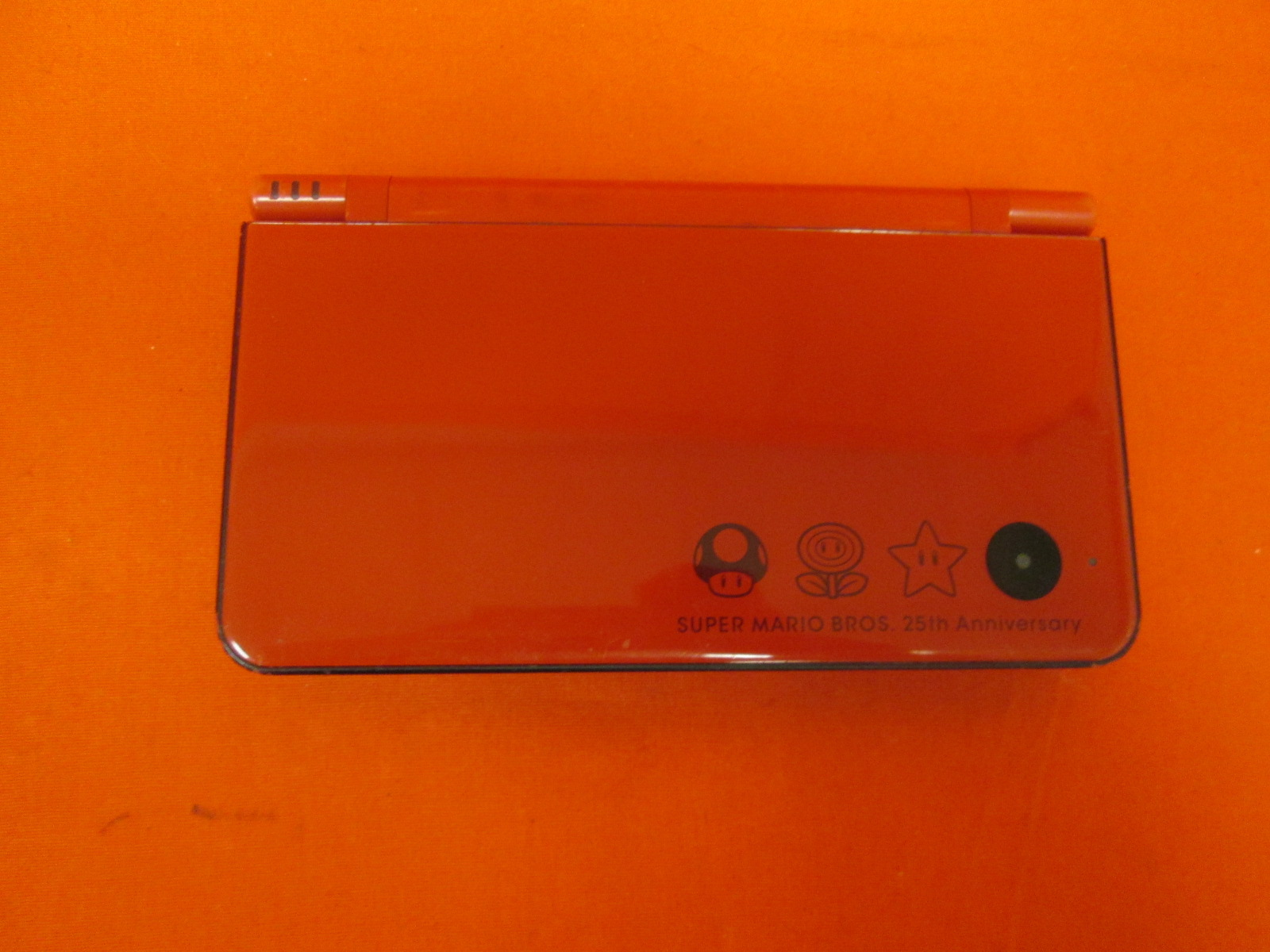 Image 1 of Nintendo DSi XL Red Super Mario Bros 25th Anniversary Edition By