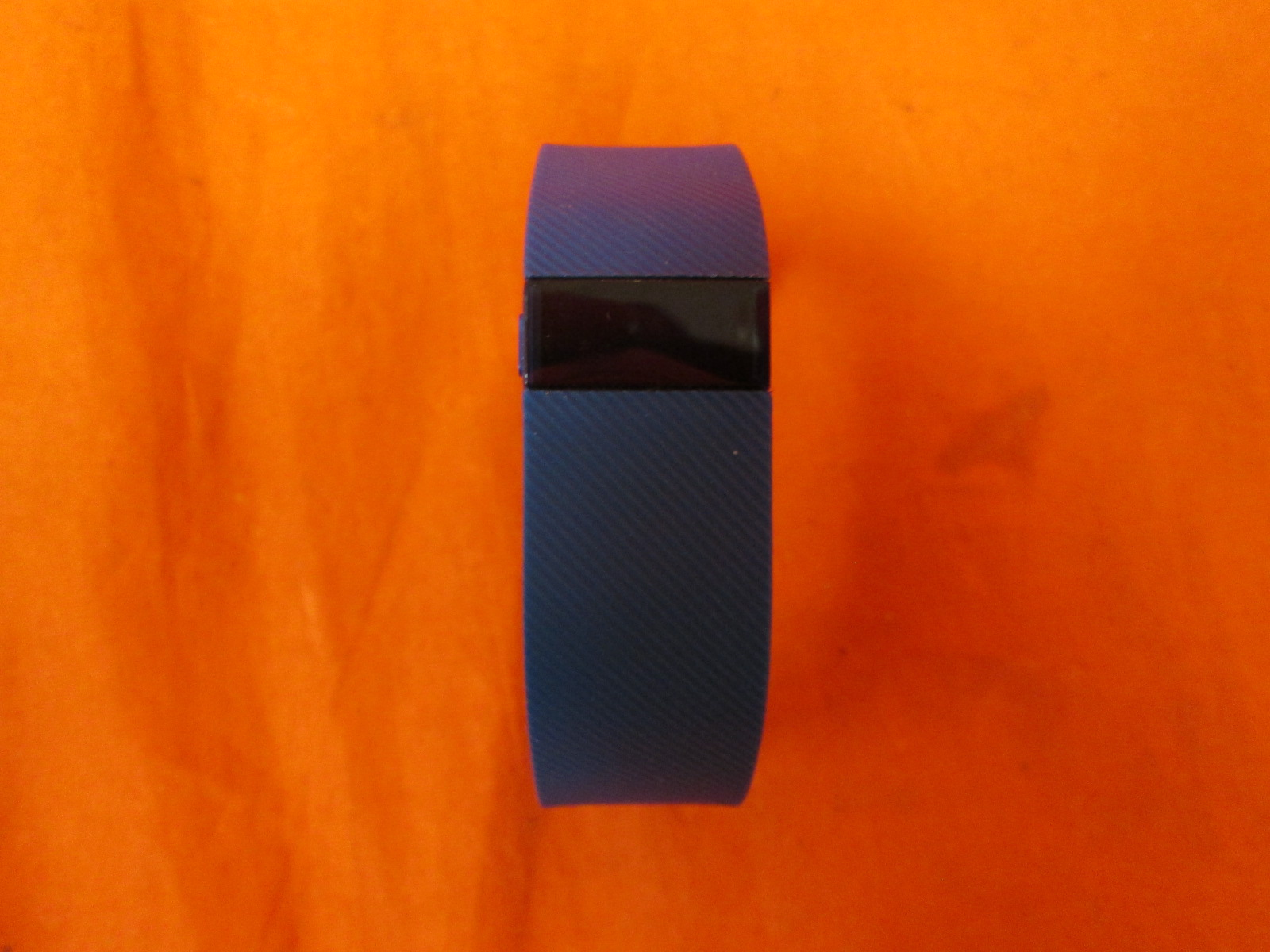 how to turn on fitbit wristband